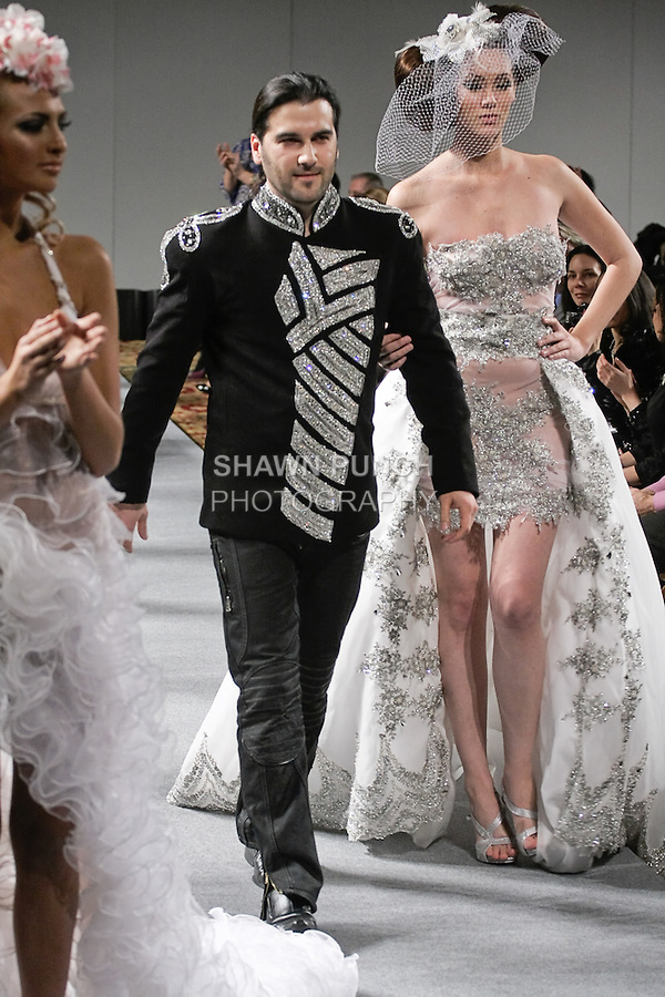 Hair stylist Elie Esper walks runway with models at the close of his Collection Amoureux - Bridal Hair Couture by Elie Esper fashion show, during Couture Fashion Week in New York, February 17 2012.