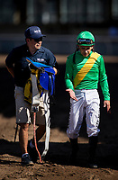 ARCADIA, CA - MARCH 11: Jockey, Mike Smith talks with his valet after the San Felipe Stakes at Santa Anita Park before being vanned off with an injury, on March 11, 2017 in Arcadia, California. (Photo by Alex Evers/Eclipse Sportswire/Getty Images)