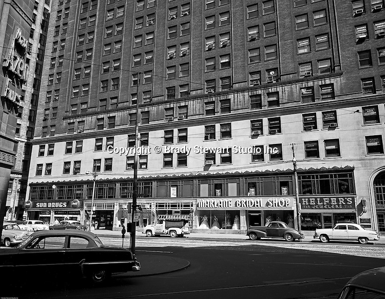 Pittsburgh PA - View of the 700 block of Liberty in Pittsburgh - 1956. View of the Clark Building from Wood Street with store fronts; Helfer's Jewelers, Marlane Bridal Shop, Sun Drugs and Max Azen's Furs - 1956.