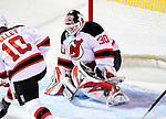 9 January 2010: New Jersey Devils' goaltender Martin Brodeur makes a second period save against the Montreal Canadiens at the Bell Centre in Montreal, Quebec, Canada. The Devils edged out the Canadiens 2-1 in overtime. Mandatory Credit: Ed Wolfstein Photo
