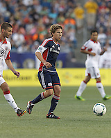 New England Revolution midfielder Scott Caldwell (6) passes the ball.  In a Major League Soccer (MLS) match, the New England Revolution (blue) tied D.C. United (white), 0-0, at Gillette Stadium on June 8, 2013.