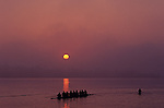 Sunrise on the Montlake Cut with eight man crew rowing on calm waters
