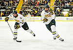 5 February 2011: University of Vermont Catamounts forward Josh Burrows (left), a Senior from Prairie Grove, IL and defenseman Dan Lawson, a Senior from Oak Forest, IL drive towards the net against the Providence College Friars at Gutterson Fieldhouse in Burlington, Vermont. The Catamounts defeated the Friars 7-1 in the second game of their weekend series. Mandatory Credit: Ed Wolfstein Photo