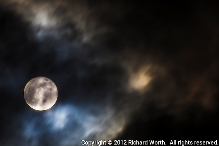 The November full moon, the Beaver Moon, through a break in the cloud cover following a day of rain storms.