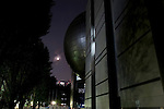 The moon partially lights up the giant dome of the planetarium which hangs above the entrance to the metropolitan science museum in Nagoya, Aichi Prefecture, Japan on 13 Oct. 2011. Photograph: Robert Gilhooly
