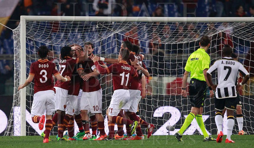Calcio, Serie A: Roma vs Udinese. Roma, stadio Olimpico, 17 marzo 2014.<br /> AS Roma forward Francesco Totti, fourth from left, celebrates with teammates after scoring during the Italian Serie A football match between AS Roma and Udinese at Rome's Olympic stadium, 17 March 2014.<br /> UPDATE IMAGES PRESS/Isabella Bonotto