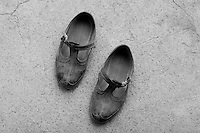 Worker shoes. Scene from a village, Stracin, Bulgaria, 2005