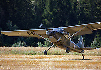 Bird Dog landing in a field. <br /> <br /> Airplanes and reenactors photographed at in connection with H&oslash;ytorptreffet, an annual event at the H&oslash;ytorp fort. <br /> <br /> H&oslash;ytorp fort is a barrage fort in the Glomma defence line, built 1912-17. On April 13th and 14th 1940 the fort was in combat against German army units . It is now protected as a national monument.<br /> <br /> &copy;Fredrik Naumann/Felix Features