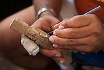 2008-12-28-Hatillo, Puerto Rico-Handcraft process of a Wise Man from the Three Kings. A puertorican artisan  carves the figure from a piece of wood with a knife.