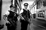 Armed Police Officers carrying Heckler and Koch 9mm MP5s, patrolling the streets of Cowes during Cowes Week. Isle of Wight England