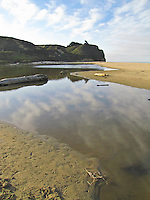 Clouds are reflected in the lagoon at Pomponio State Beach on the California Coast