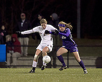 """Boston College defender Alyssa Pember (6) and University of Washington forward Annie Sittauer (20) battle for the ball. In overtime, Boston College defeated University of Washington, 1-0, in NCAA tournament """"Elite 8"""" match at Newton Soccer Field, Newton, MA, on November 27, 2010."""