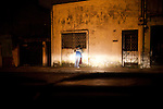 A young couple is found kissing late at night in Zone 1, Guatemala City, Guatemala, on Thursday, Nov. 3, 2011.