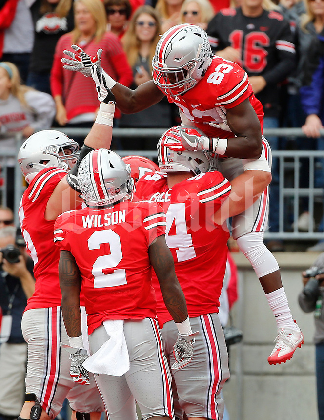Ohio State Buckeyes offensive lineman Billy Price (54) hoists wide receiver Terry McLaurin (83) after making a 14-yard touchdown catch during the first half of the NCAA football game at Ohio Stadium in Columbus on Oct. 1, 2016. (Adam Cairns / The Columbus Dispatch)