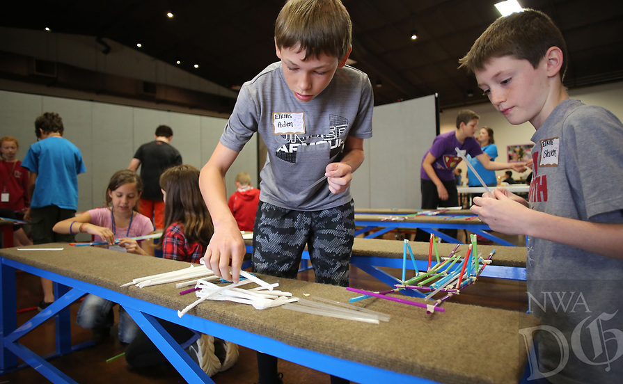 NWA Democrat-Gazette/DAVID GOTTSCHALK  Steven Holland (right), a sixth grade student at Elkins Middle School, uses straws and tape with Aden Williams, also a sixth grade student, Monday, April, 17, 2017, to build a bridge as they compete in the Mystery Bridge challenge during the Northwest Arkansas Science Olympian Tournament 2017 at Prairie Grove Christian Church in Prairie Grove. The two day tournament matches both elementary and middle school students from the area in events that include a Junkyard Challenge, Balloon Joust and Marshmallow Catapult.