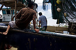 Fishermen and dockworkers load the H&R shrimp boat at Dean Blanchard Seafood, Inc. in Grand Isle, LA on June 24, 2010 where a fishing ban has been put in place due to the B.P. oil spill. The H&R crew will head west in hopes to find open fishing waters after waiting two months for B.P. to hire their boat.