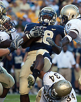 Pittsburgh running back Dion Lewis (28) is surrounded by Navy defenders. The Pittsburgh Panthers defeated the Navy Midshipmen 27-14 at Heinz Field, Pittsburgh, PA.