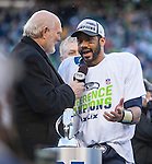 Hall of Fame NFL quarterback, and  FOX sports broadcaster Terry Bradshaw, left,  quarterback Russell Wilson after their 28-22 overtime in the NFC Championship game against the  Green Bay Packers at CenturyLink Field in Seattle, Washington on January 18, 2015.  The Seattle Seahawks beat the Green Bay Packers in overtime 28-22 for the NFC Championship Seattle.  ©2015. Photo by Jim Bryant, All Rights Reserved.