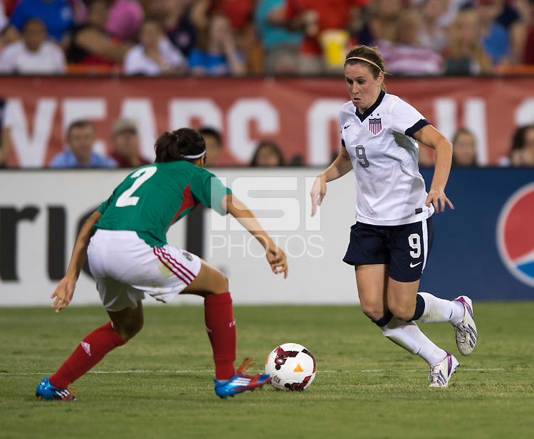 Heather O'Reilly, Kenti Robles. The USWNT defeated Mexico, 7-0, during an international friendly at RFK Stadium in Washington, DC.  The USWNT defeated Mexico, 7-0.