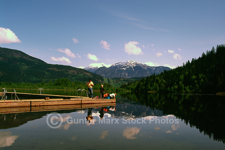"""Children and Father fishing at """"One Mile Lake"""" in the Coast Mountains, near the Village of Pemberton, BC, British Columbia, Canada"""
