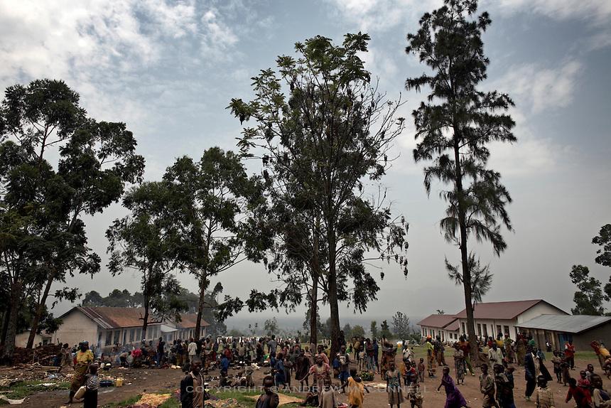 Displaced people take refuge in the grounds of a school in the town of Rutshuru, North Kivu, DRC.