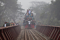 Bangladeshi Muslim devotees going to attend the prayer in an over-crowded train during the World Congregation of Muslims, or Biswa Ijtema, on the outskirts of Dhaka, Bangladesh. Jan 11, 2015