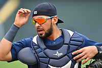 Catcher Ali Sanchez (20) of the Columbia Fireflies warms up before a game against the Lexington Legends on Sunday, April 23, 2017, at Spirit Communications Park in Columbia, South Carolina. Lexington won, 4-2. (Tom Priddy/Four Seam Images)