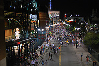 Tiger fans exit Comerica Park and fill Montcalm Street after an evening game..