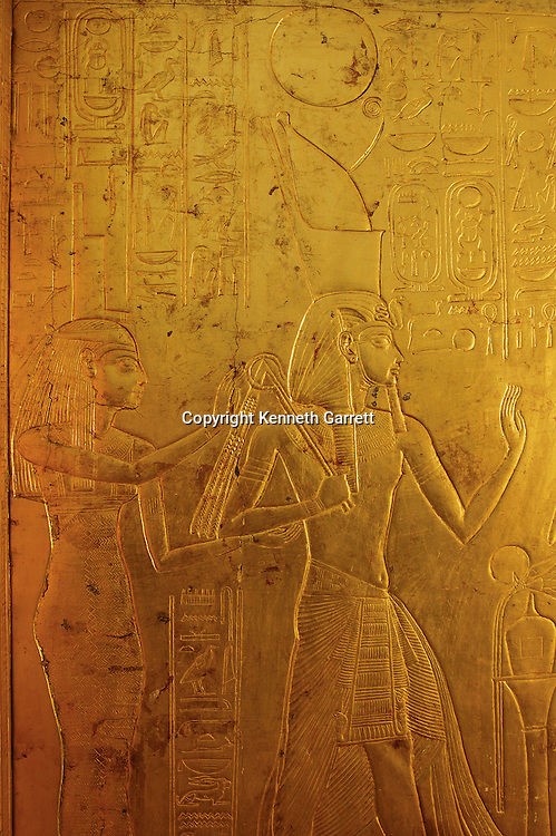 Gold shrine surrounding sarcophagus depicts Goddess Isis,KV 62,  Tutankhamun and the Golden Age of the Pharaohs,  Page 208