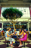 A multi-ethnic (Japanese-American/Caucasian) family enjoyes lunch at a favorite and long-established local fast-food eatery chain in Hawaii.