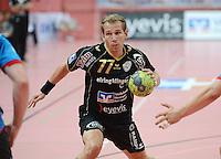 Handball 1. Bundesliga  2012/2013  in der Paul Horn Arena Tuebingen 08.09.2012 TV Neuhausen - TSV Hannover-Burgdorf Ralf Bader (TV Neuhausen) mit Ball