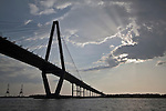Arthur Ravenel Jr Bridge with sun rays beaming from behind a cloud charleston south carolina cooper river bridge