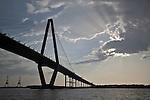 Arthur Ravenel Jr Bridge with sun rays beaming from behind a cloud charleston south carolina cooper river bridge