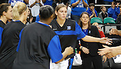 Coach P watches Allison Vernerey high-five her teammates during the starting lineups. (Photo by Rob Rowe)