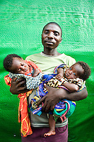 Repakiba Pierre with his twin two month old babies Erica and Heritien, born in the Mugunga I IDP (Internally Displaced Persons) camp.