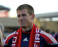 Chicago Fire forward Brian McBride (20) listens to a tribute from teammate CJ Brown.  This game was McBride's last home game for the Fire.  The Chicago Fire tied DC United 0-0 at Toyota Park in Bridgeview, IL on Oct. 16, 2010.