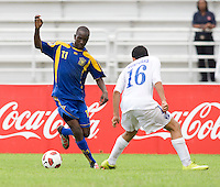 Arnaldo Alvarado (16) of Honduras stays close to Jabarry Chandler (11) of Barbados  during the group stage of the CONCACAF Men's Under 17 Championship at Catherine Hall Stadium in Montego Bay, Jamaica. Honduras defeated Barbados, 2-1.