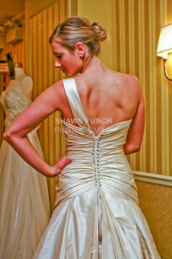 Model wears Lea-Ann Belter's Danielle wedding dress at the Wedding Channels Bridal Market in  Intercontinental The Barclay New York October 17 2009. Back half body.