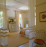The spacious main bedroom has been decorated in natural colours with French windows on two sides opening onto the terrace