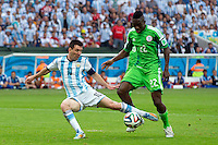 Lionel Messi of Argentina and Kenneth Omeruo of Nigeria