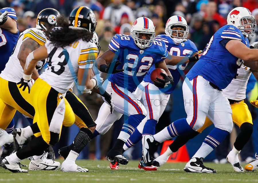 ORCHARD PARK, NY - NOVEMBER 28:  Fred Jackson #22 of the Buffalo Bills runs with the ball against the Pittsburgh Steelers defense during the game on November 28, 2010 at Ralph Wilson Stadium in Orchard Park, New York.  (Photo by Jared Wickerham/Getty Images)