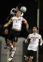 COLLEGE PARK, MD - NOVEMBER 25, 2012: Dan Metzger (7) of the University of Maryland looses a header to Pedro Ribeiro (10) of Coastal Carolina University during an NCAA championship third round match at Ludwig Field, in College Park, MD, on November 25. Maryland won 5-1.