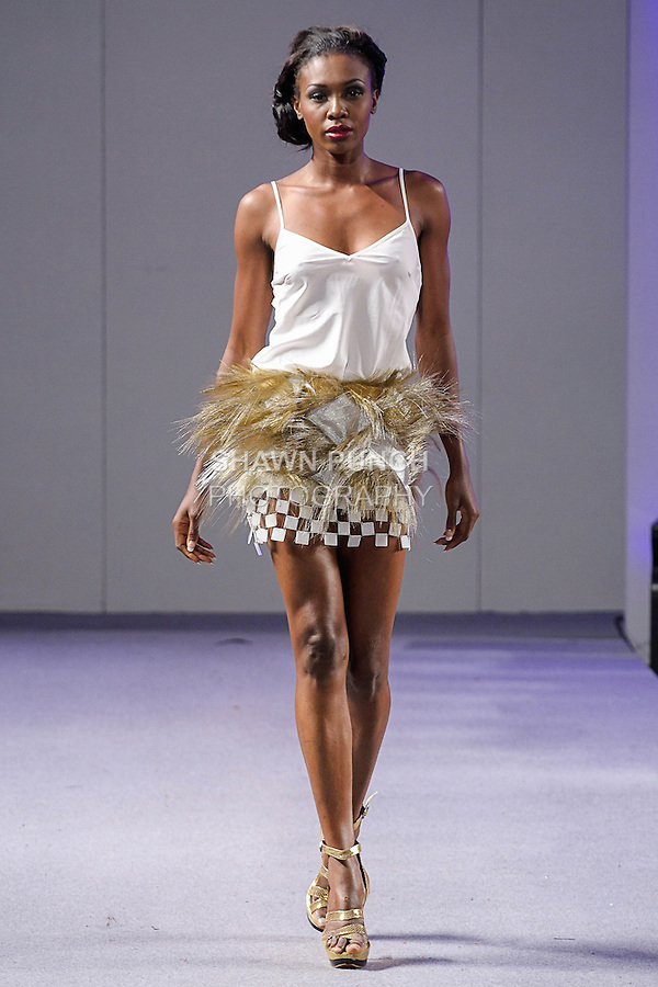 """Model walks runway in an outfit from the AFANADOR Spring Summer 2013 """"20s With Power"""" collection by Jorge Afanador, during Couture Fashion Week New York Spring 2013, on September 17, 2012."""