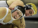 Vista Ridge High School's Colby Wilson (front) struggles against Bowie's Brian Dorsey during the boys' finals of the Region IV wrestling tournament at Littleton Gymnasium on Saturday, Feb. 11, 2012. Dorsey won to become the 170 lb. champion.