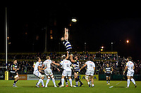 Matt Garvey of Bath Rugby rises high to win lineout ball. West Country Challenge Cup match, between Bath Rugby and Exeter Chiefs on October 10, 2015 at the Recreation Ground in Bath, England. Photo by: Patrick Khachfe / Onside Images