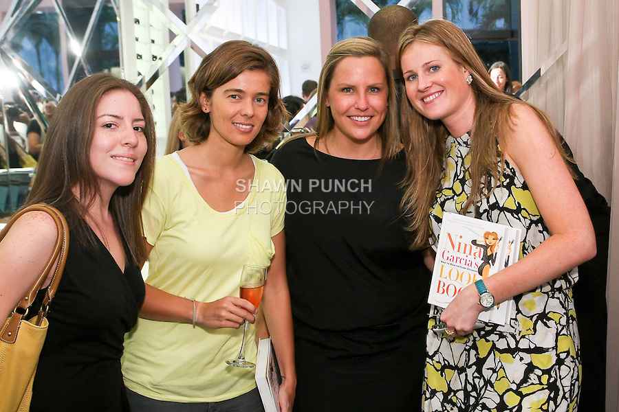 """Marie Claire PR team and guest pose during Nina Garcia's """"Look Book: What To Wear For Every Occasion"""", book release party with Marie Claire at Tous Rockefeller Center, August 17, 2010."""