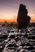 Sunset over rock formations near Rapahoe near Greymouth, West Coast, New Zealand