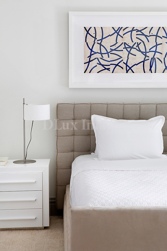 Bed with beige headboard in modern bedroom