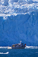 Tourists view tidewater glacier, Kenai Fjords National Park, Alaska