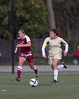 Boston College defender Hannah Cerrone (11) brings the ball forward. Florida State University defeated Boston College, 1-0, at Newton Soccer Field, Newton, MA on October 31, 2010.